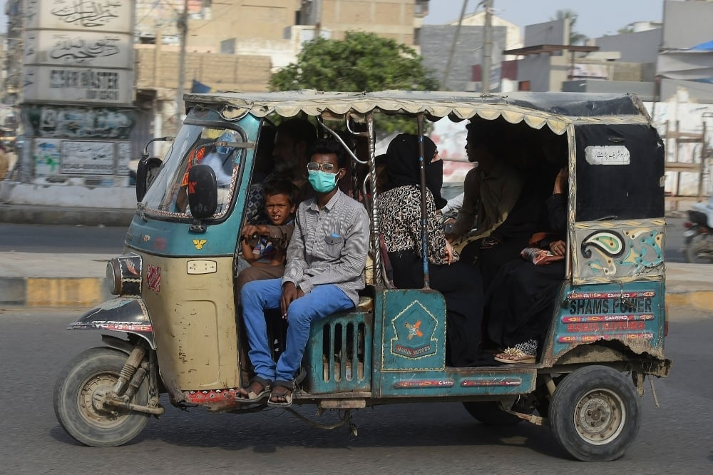 Commuters drive through a street after a nine-day nationwide lockdown imposed to curb the spread of the coronavirus was lifted in Karachi on May 17.  — AFP