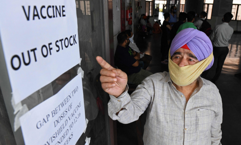 A man gestures to notices displayed in a civil hospital indicating about the Covid-19 vaccine being out of stock in Amritsar on Monday. — AFP