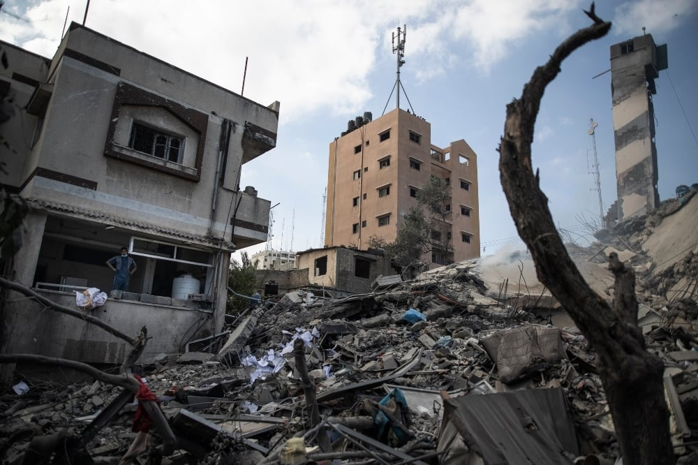 The remains of a six-story building destroyed by an early morning Israeli airstrike are seen in Gaza City on May 18. — AP