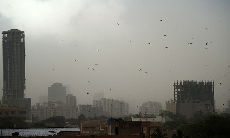 A general view shows Karachi on May 18 during a dust storm. — AFP