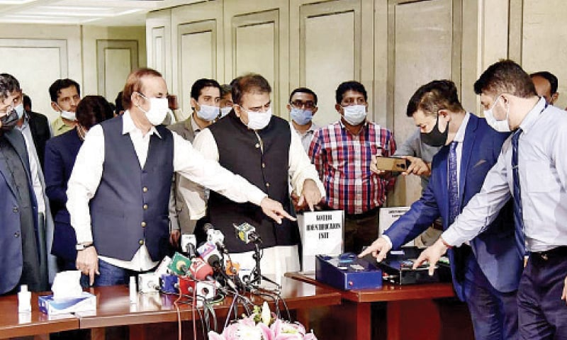 Information Minister Fawad Chaudhry and Adviser to the Prime Minister on Parliamentary Affairs Dr Babar Awan brief mediapersons about the electronic voting machine on Wednesday. — APP