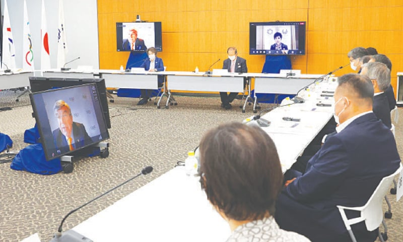 TOKYO: International Olympic Committee (IOC) president Thomas Bach (on screen) delivers an opening speech at a meeting of the IOC Coordination Commission for the Tokyo 2020 Olympics on Wednesday.—AFP