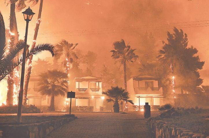 FIRE engulfs a village near Corinth.—AP
