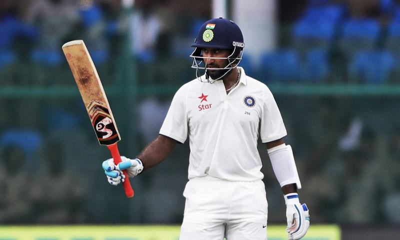 In this file photo, India's Cheteshwar Pujara raises his bat after making half century against New Zealand during their first test match in Kanpur, September 22, 2016. — AFP