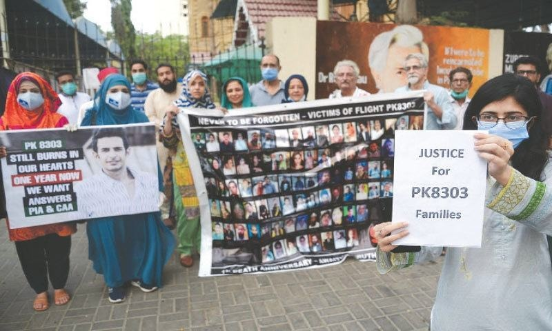 Relatives of the crash victims protest outside the Karachi Press Club earlier this month. — Shakil Adil/White Star/File