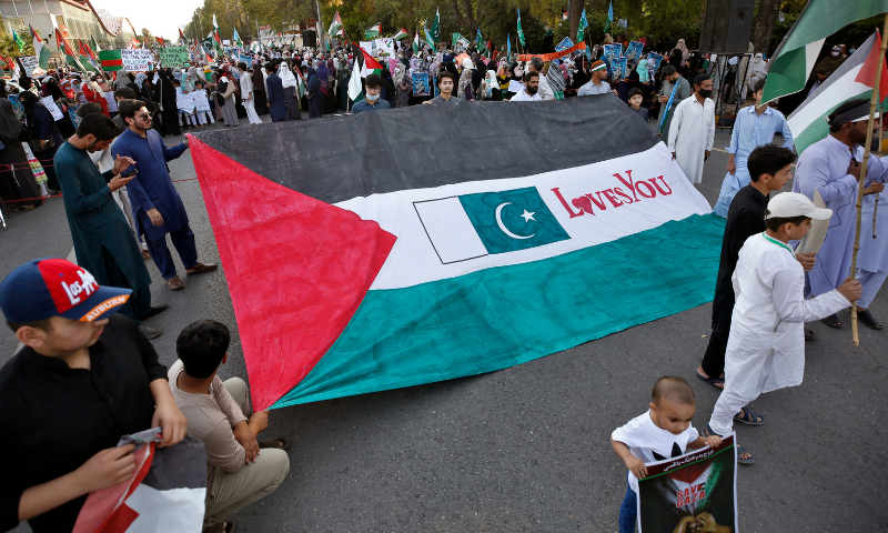 Demonstrators display a huge Palestinian flag during a rally in support of Palestinians, in Islamabad on Wednesday.