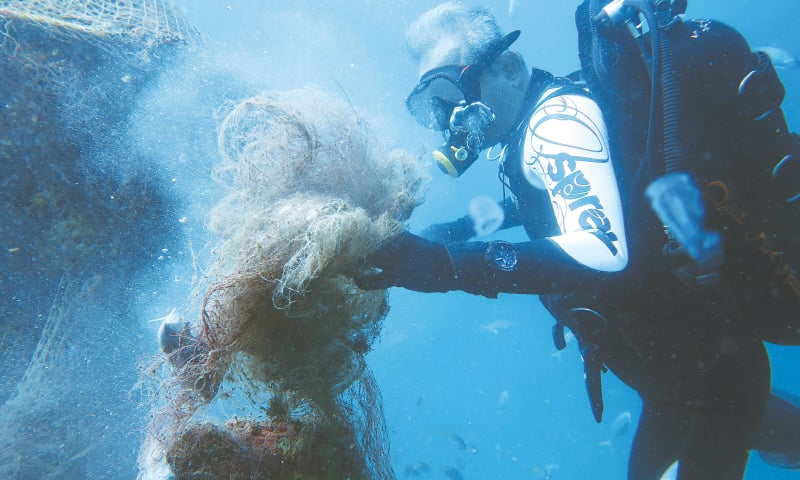 It takes a very skilled and experienced diver to cut these ghost nets that have been trapping marine life | Photos by Muhammad Iqbal