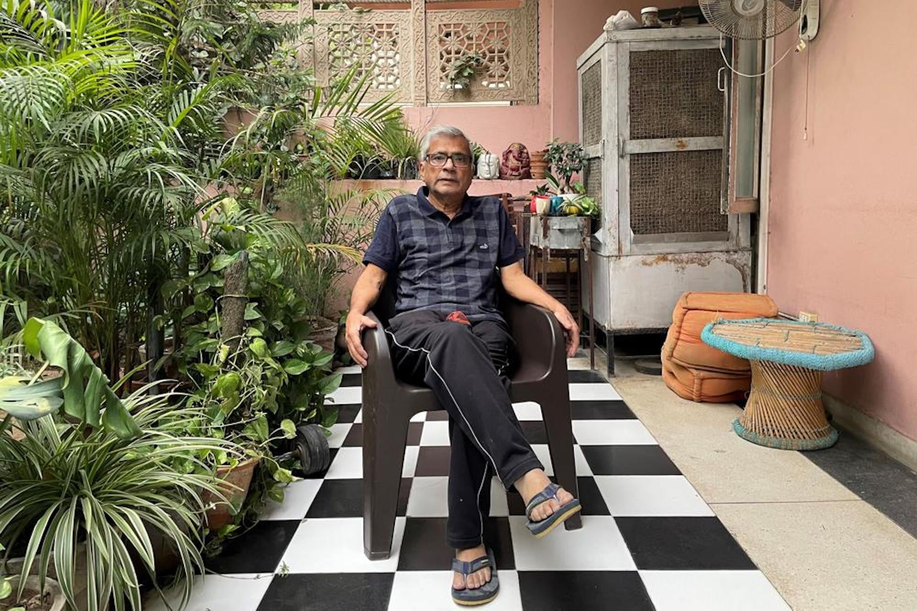In this photo released by Chakravorty family, Prabir Chakravorty, 73, a Covid-19 survivor, sits in the garden area of his home in New Delhi, India on May 17, 2021. Chakravorty, the family patriarch and widower, a construction executive was treated at home for the coronavirus. — Chakravorty family via AP