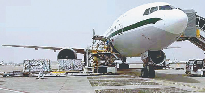 BEIJING: A batch of two million doses of Sinovac vaccine is being loaded onto a special PIA flight at the airport on Sunday.—APP