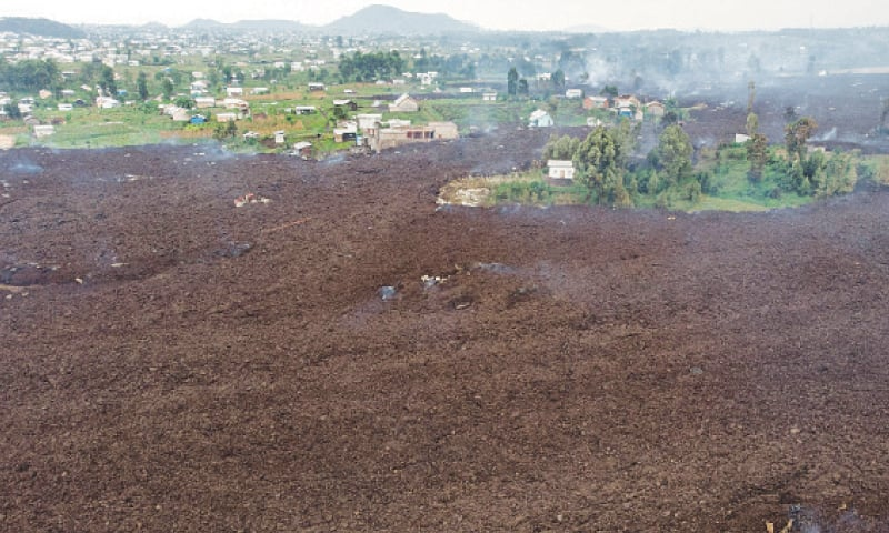 AN aerial view shows debris engulfing buildings in a  village near Goma.—AFP