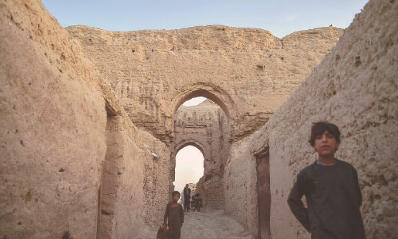 A MARCH 27 picture shows displaced Afghan children walking among ruins of the palace.—AFP