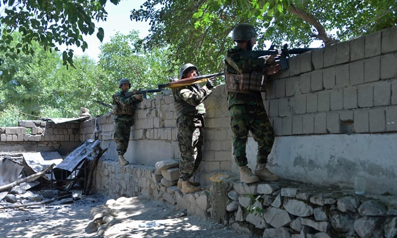 Members of Afghan security forces take their positions during a clash between Taliban and Afghan forces in Mihtarlam, Afghanistan on May 24. — AFP