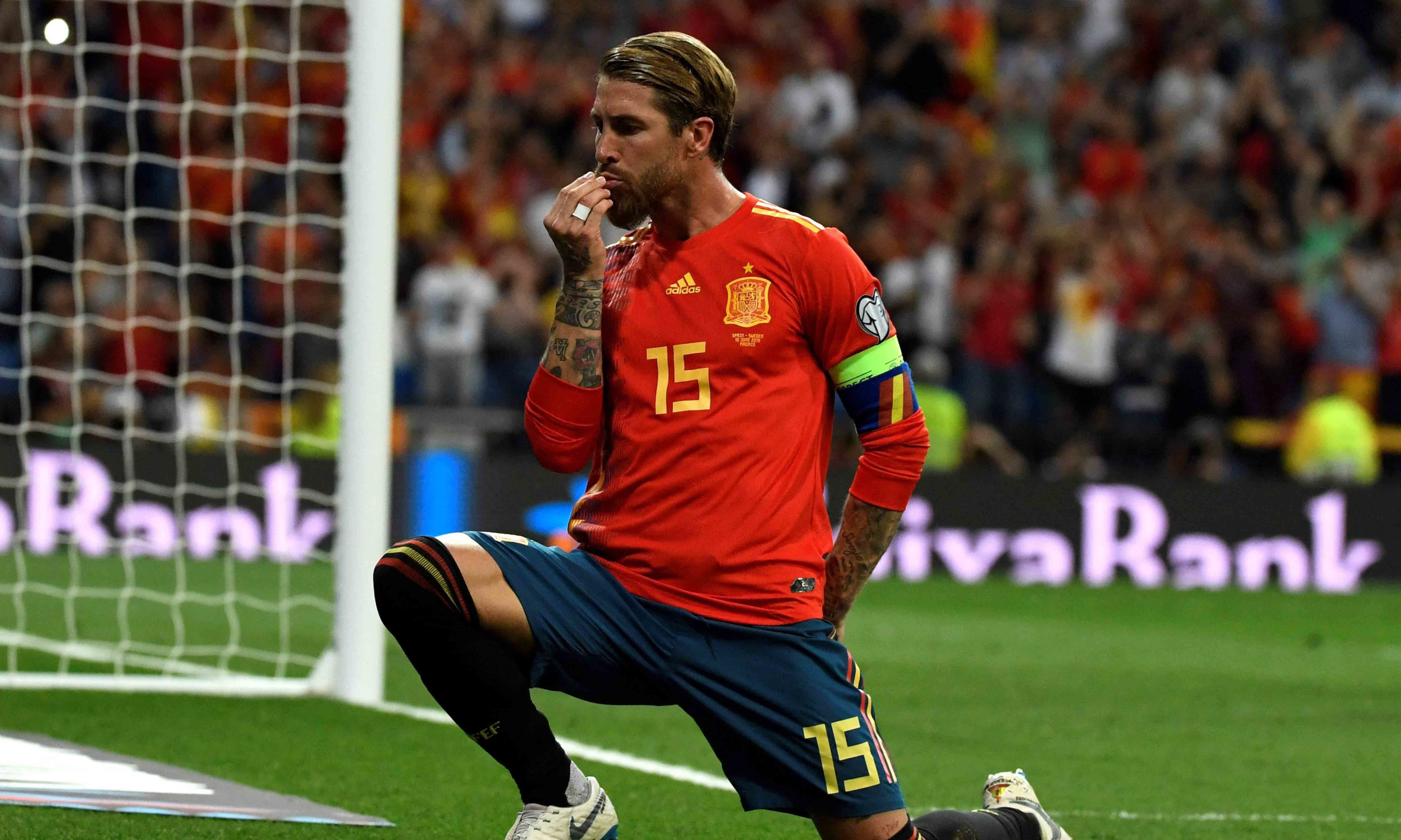 Spain's defender Sergio Ramos celebrates after scoring a penalty during the UEFA Euro 2020 group F qualifying football match between Spain and Sweden at the Santiago Bernabeu stadium in Madrid on June 10, 2019. — AFP
