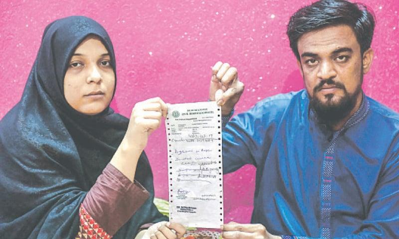 Mustafa's parents show the prescription slip of Civil Hospital Karachi.—Fahim Siddiqi/White Star