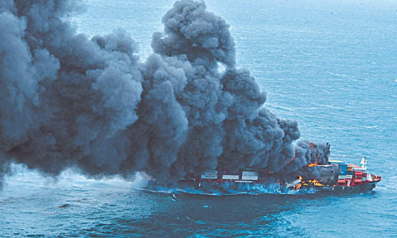 SMOKE rises from a fire onboard the container ship.—Reuters
