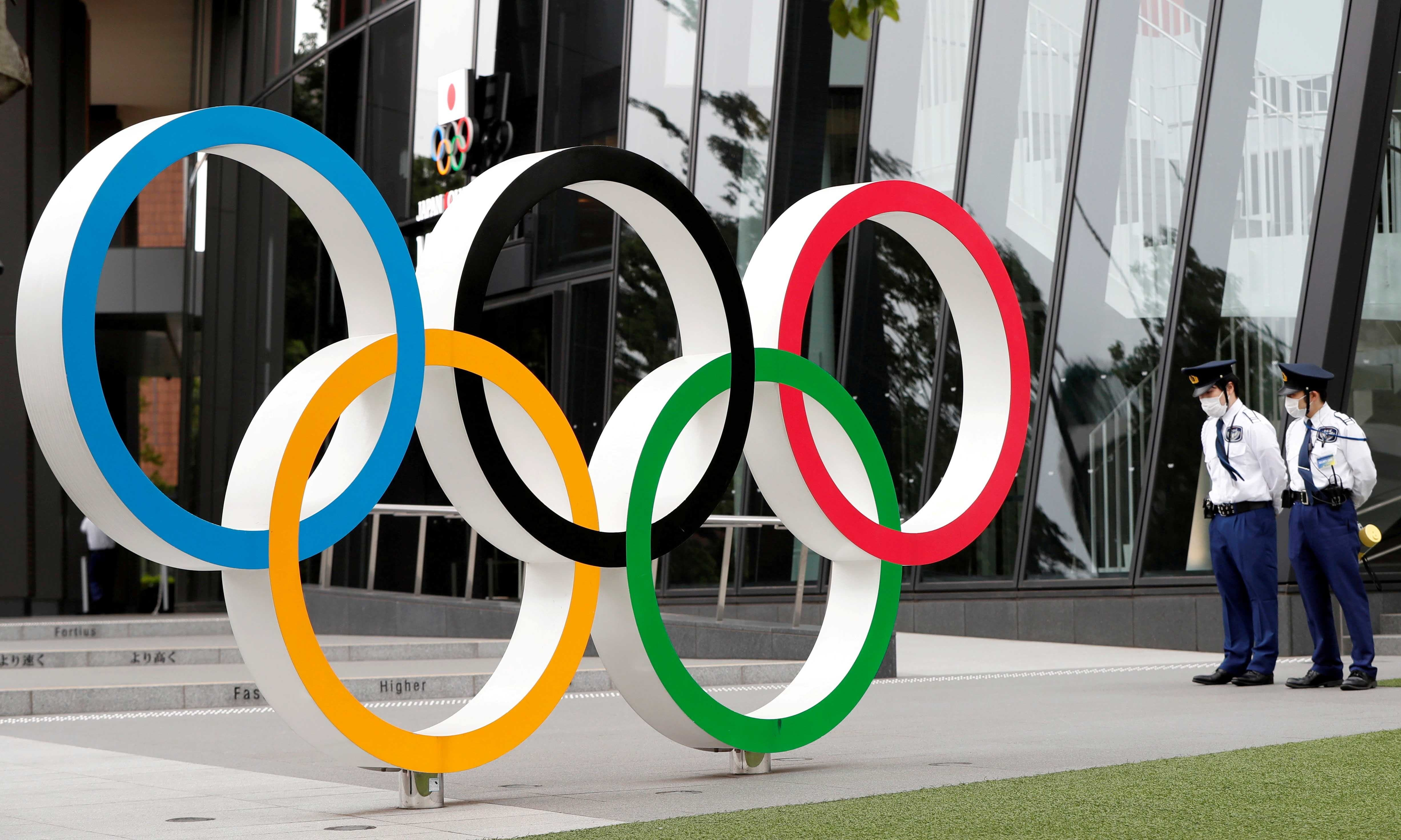 Security personnel stand guard near the Olympic rings monument on May 18. — Reuters