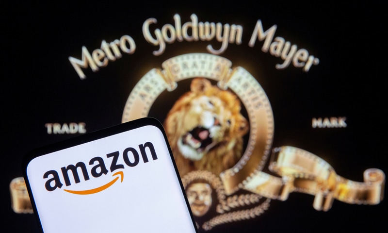 Smartphone with Amazon logo is seen in front of displayed MGM logo in this illustration. — Reuters