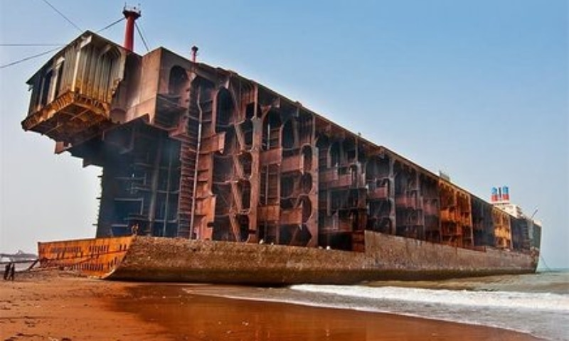A hulking oil tanker stands with its bow removed on Gadani beach. — Photo by Nadir Siddiqui/Dawn.com and Fehd Siddique