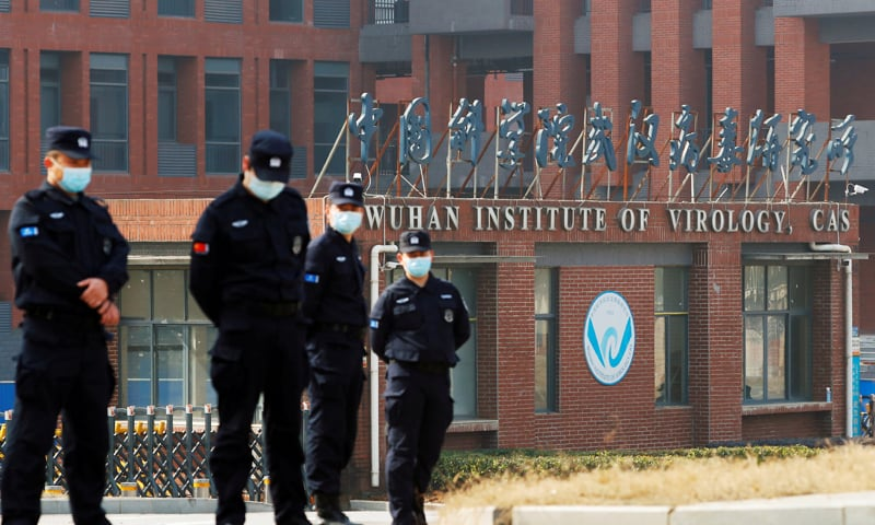 In this file photo, security personnel keep watch outside the Wuhan Institute of Virology during a visit by a World Health Organisation team tasked with investigating the origins of the coronavirus disease on February 3. — Reuters/File