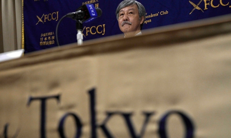 Dr. Naoto Ueyama, chairman of Japan Doctors Union, poses for photographers prior to a press conference on May 27. — AP