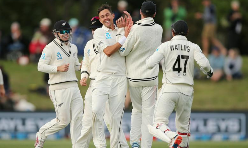 New Zealand's Trent Boult celebrates bowling India's Cheteshwar Pujara with teammates. — Reuters/File