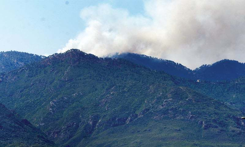 This file photo shows smoke rising from a fire in the Margalla Hills. — White Star