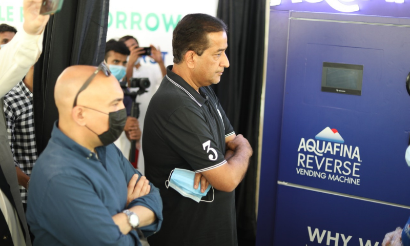 Prime Minister's Special Assistant on Climate Change Malik Amin Aslam said the machine would encourage people to recycle. — Photo courtesy Ministry of Climate Change Twitter
