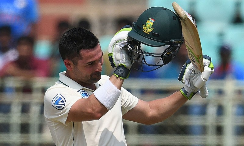 In this file photo, Dean Elgar raises his bat after scoring 100 runs during the third day's play of the first Test match between India and South Africa at the Dr. Y.S. Rajasekhara Reddy ACA-VDCA Cricket Stadium in Visakhapatnam on October 4, 2019. — AFP/File