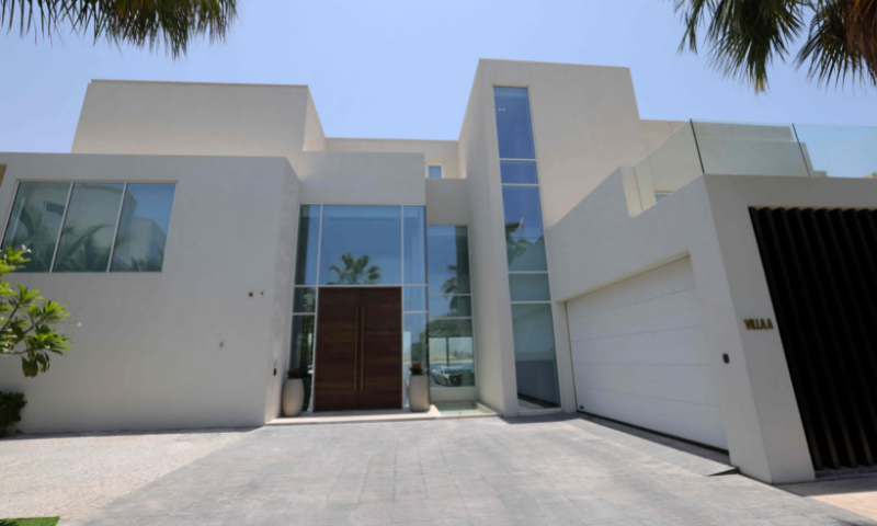 This picture shows the entrance of a luxury villa for sale on one of the Palm Jumeirah man-made islands, on the coast of the Gulf emirate of Dubai. — AFP