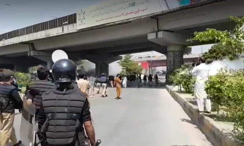A view of the police action in Peshawar on Monday. — DawnNewsTV