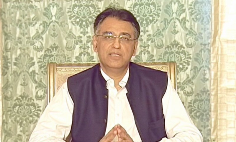 Federal Minister for Planning, Development and Special Initiatives Asad Umar briefs the media after a NCC meeting in Islamabad. — DawnNewsTV