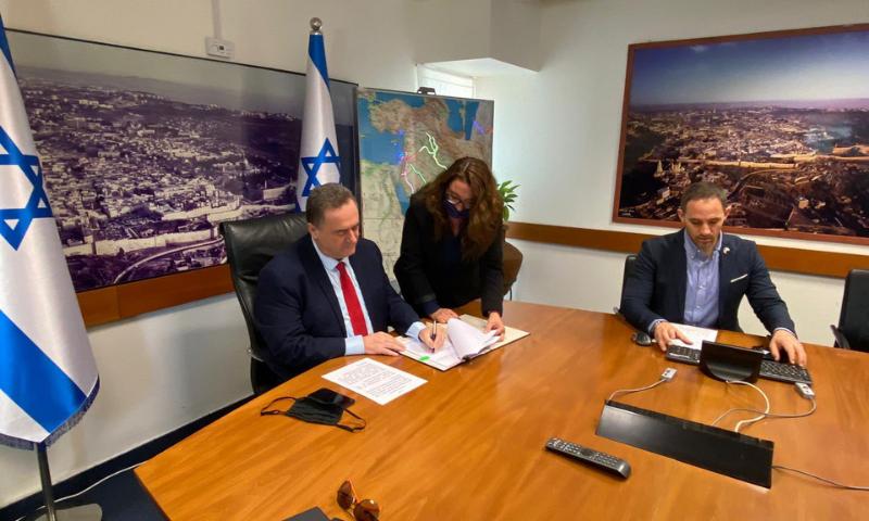 Israeli Finance Minister Israel Katz and UAE Finance Minister Obeid Humeid al-Tayyar sign the tax treaty on Monday. — Photo courtesy Israel Katz Twitter