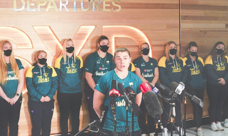 SYDNEY: Australian softball player Jade Wall (C) talks to the media prior to the squad's departure for the Tokyo Olympics, at Sydney International Airport on Monday.—AFP