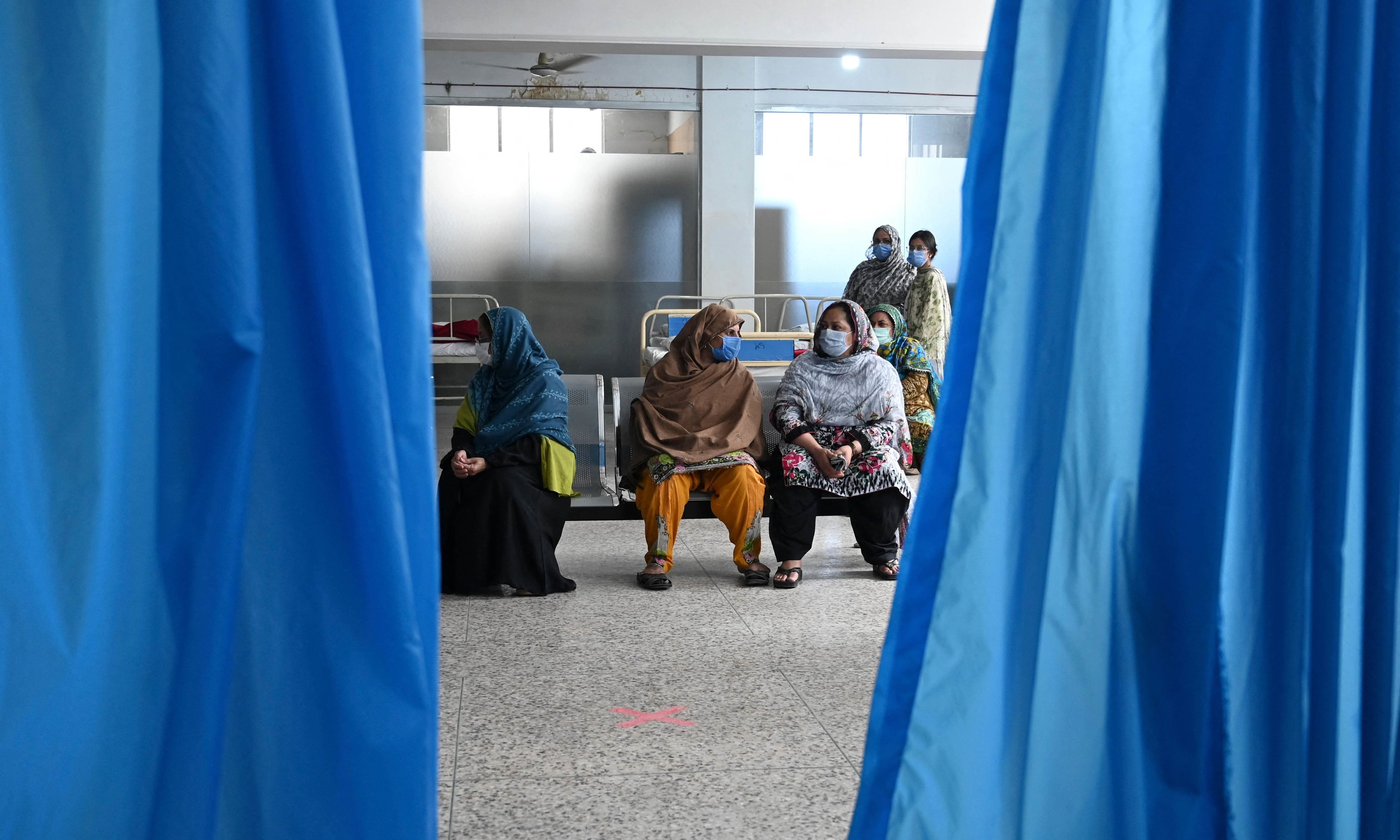 People wait for their turn to get a Covid-19 coronavirus Sinovac vaccine at the Red Crescent vaccination centre in Rawalpindi on May 24. — AFP/File