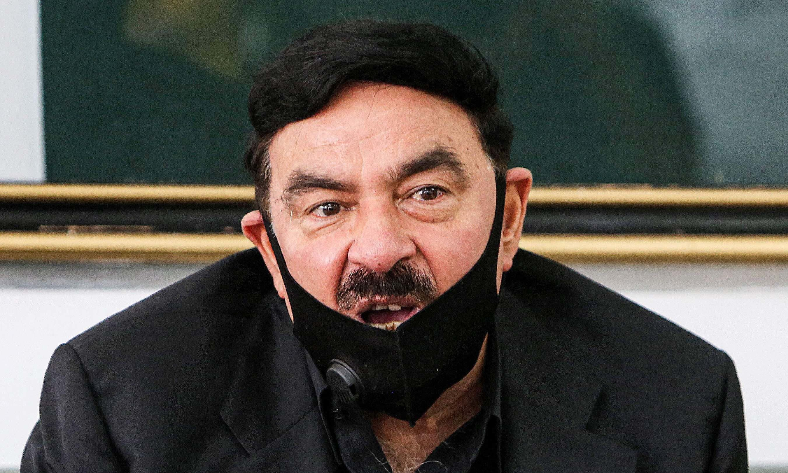 Interior Minister Sheikh Rasheed Ahmad speaks to reporters at the Pakistani embassy in Kuwait City on May 31. — AFP