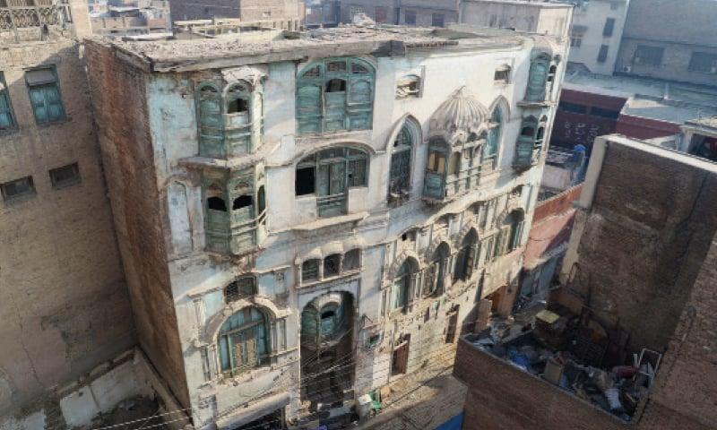 The entrance to Dilip Kumar's ancestral residence in Peshawar. (Right) The facade of Raj Kapoor's haveli. — White Star