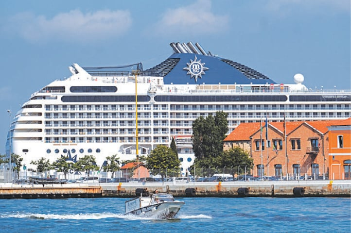 CRUISE ship MSC Orchestra arrives in Venice despite protests calling for an end to cruises passing through the lagoon city.—Reuters