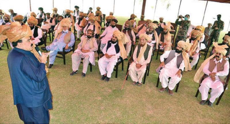 Interior minister Sheikh Rashid Ahmed addresses a jirga of tribal elders in Wana, South Waziristan, on Friday. — APP