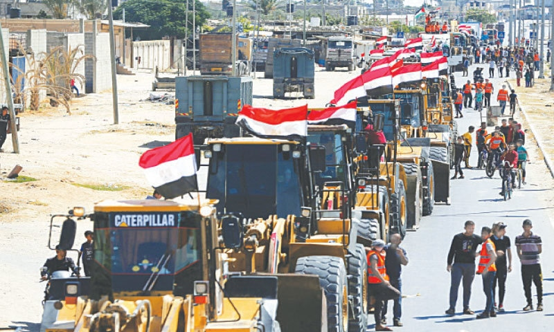 GAZA STRIP: Building equipment and other heavy machines sent by the Egyptian authorities reach the Palestinian enclave on Friday.— Reuters