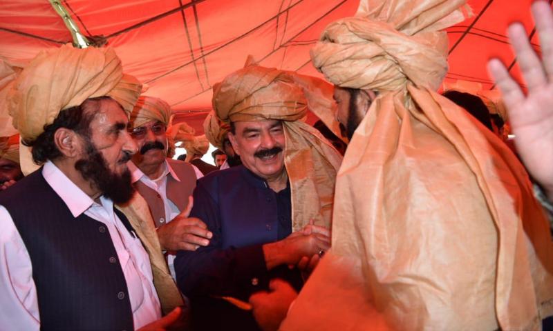 Tribal elders of South Waziristan talk to Interior Minister Sheikh Rashid Ahmed at a jirga in Wana on Friday. — PID