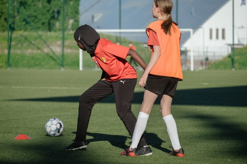 Nasro Bahnaan Hulbade (L), wearing a sports hijab, plays the ball as she attends a football training session at the MUP Stadium in Vantaa, Finland, on June 1. — AFP