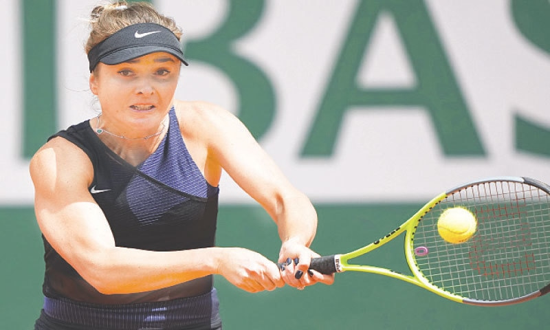 PARIS: Ukraine's Elina Svitolina hits a return to Barbora Krejcikova of the Czech Republic during their third-round match at the French Open on Saturday.—AP