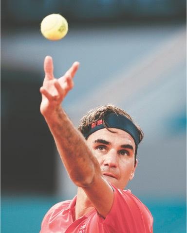 ROGER Federer serves to German rival Dominik Koepfer during their third-round match.—AP