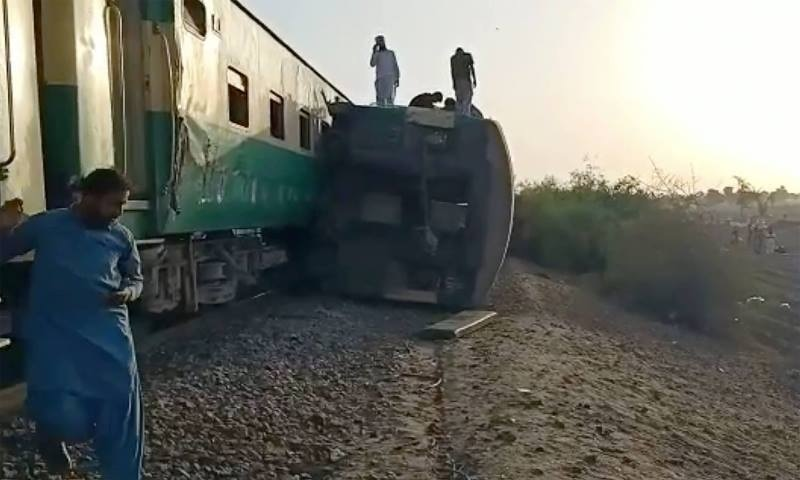 This image from a video shows the site of a train collision in Ghotki. — AP