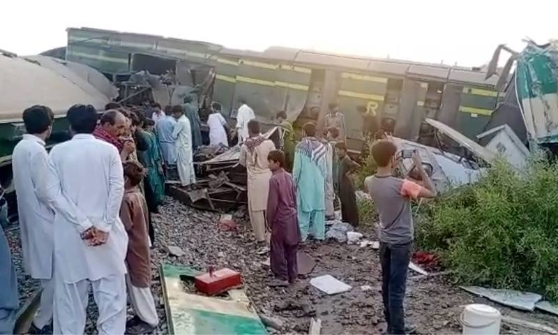 This image from a video shows people gathering at the site of a train collision in Ghotki. — AP