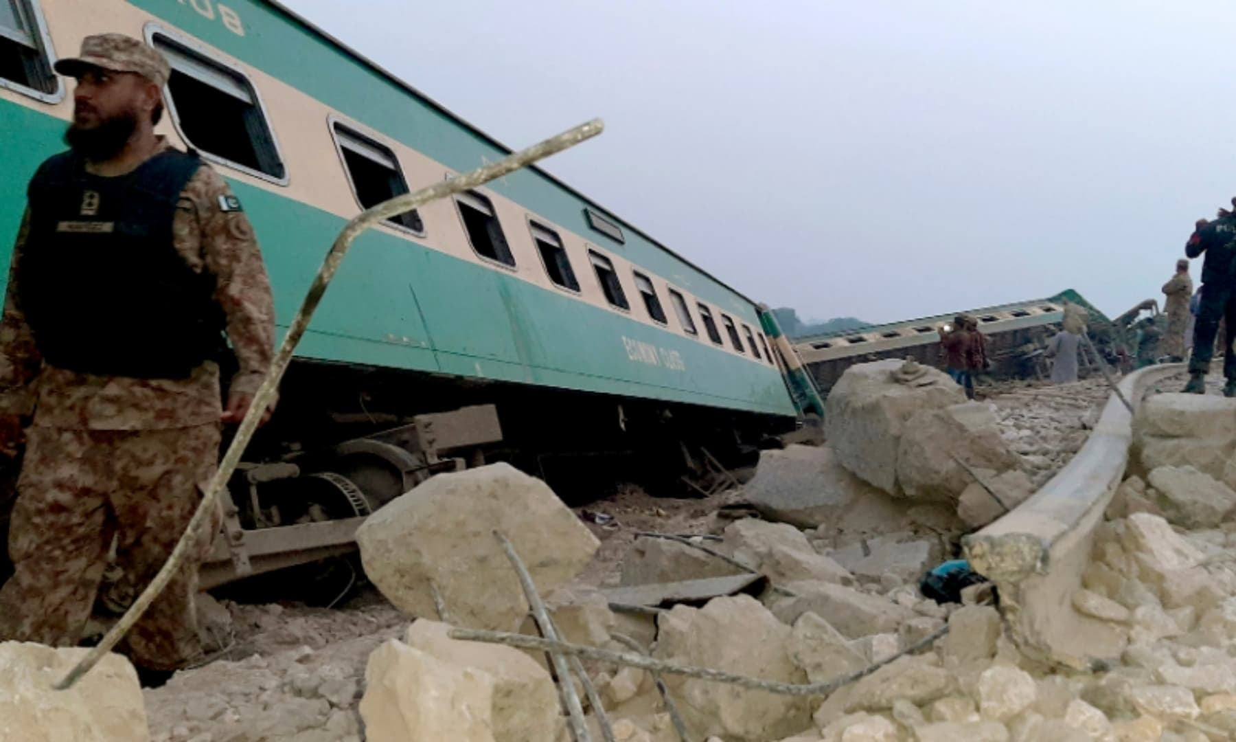 Army, police and rescue workers gather at the site of a derailed train near Rohri, March 7, 2021. — AP
