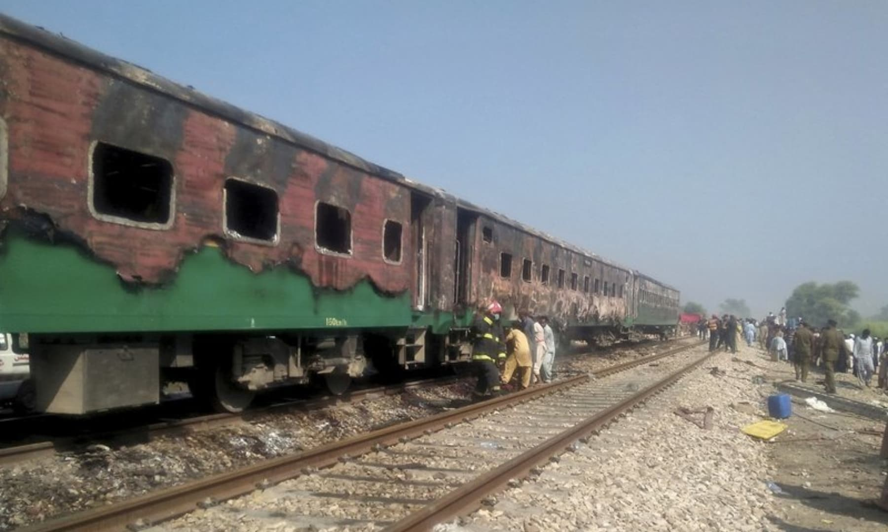 Officials examine a train damaged by a fire in Liaquatpur, Oct 31, 2019. — AP/File