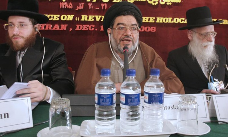 In this December 11, 2006, photo, Mohtashamipour speaks, as Rabbi Moishe Arye Friedman, left, from Austria, and Rabbi Ahron Cohen from England, at a conference on the Holocaust, in Tehran. — AP/File