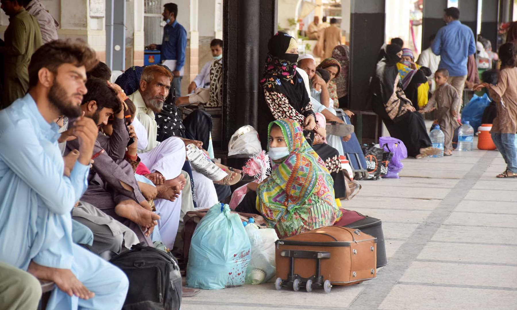 Passengers await the arrival of trains at Hyderabad railway station following the accident in Daharki. — Umair Ali
