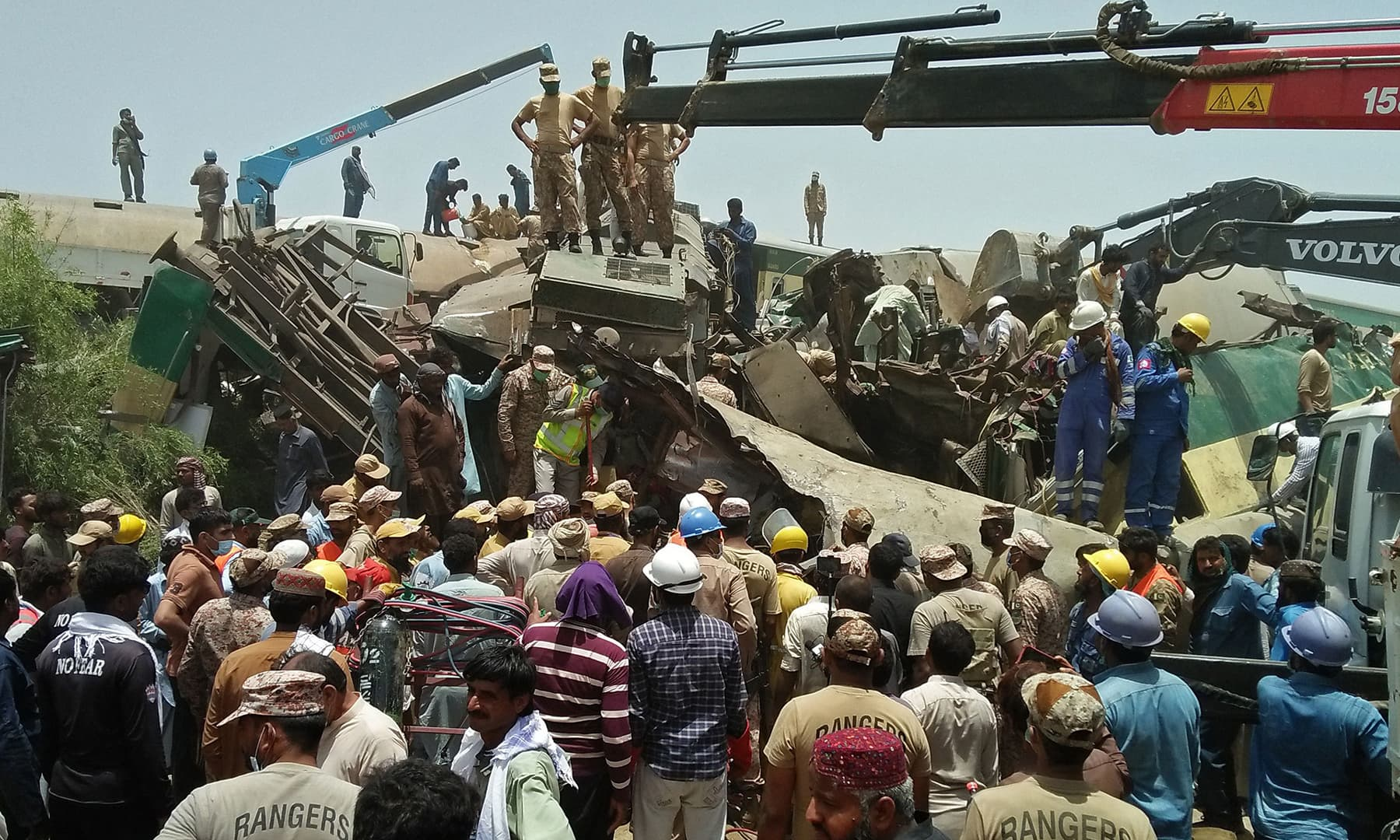 Security personnel carry out rescue operation at the site of a train accident in Daharki. — AFP